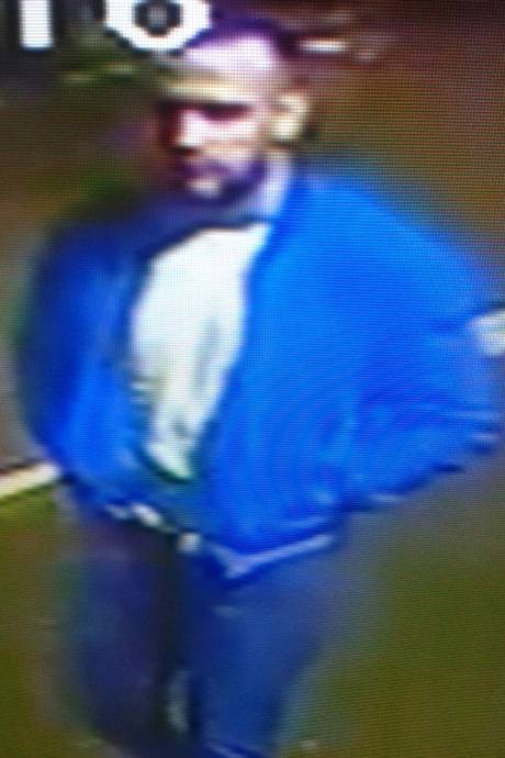 Male suspect wearing blue jacket